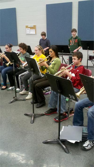 Fox 8 News Reporter Annette Lawless plays trumpet with the 7th Grade Band!