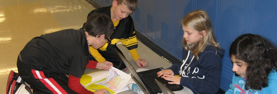 OFIS Students Collaborating During Group Research Activity