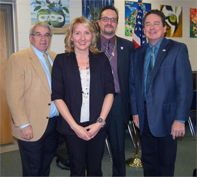 Math teacher Christine O'Brien with board President Jim Weisbarth, left, Superintendent Dr. Jim Lloyd and OFMS Principal Mark Kurz.